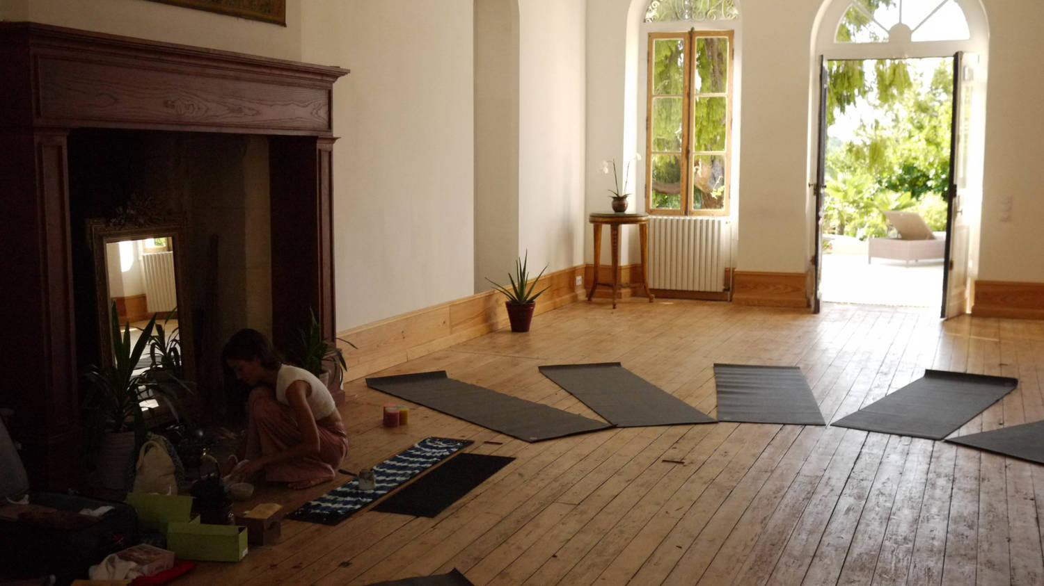 Chateau Fengari's studio set up for yoga, with mats and bolsters in a circle.