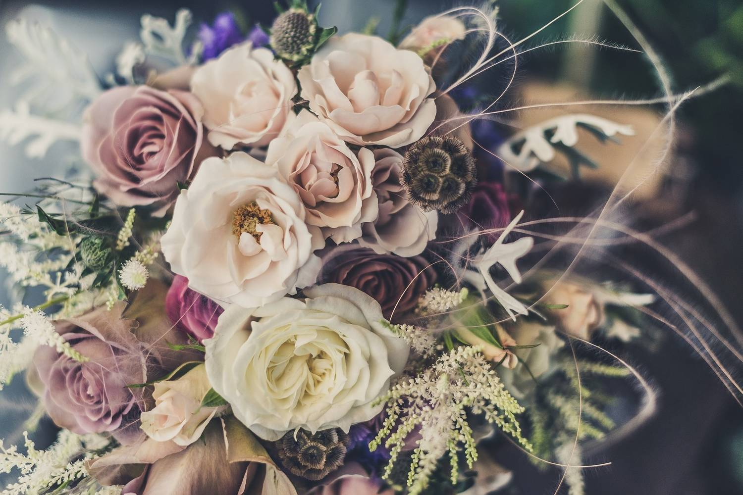 Stunning wedding bouquet made of muted coloured flowers